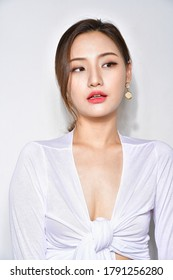 sexy and beautiful Korean woman in white shirt