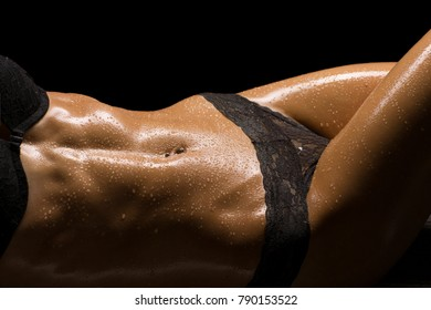 Sexy and beautiful muscular woman body part, wet skin