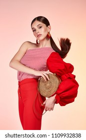 Sexy beautiful pretty young woman long brunette hair slinkybody shape natural organic make up wear fashion clothes silk blouse cotton trousers hold hand bag accessory jewelry model glamour style.