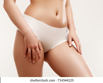 Sexy beautiful slim woman body isolated on gray background. Fashion model with health skin. Skin care concept