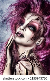 Sexy  beautiful witch with Halloween makeup. Beautiful pink hair