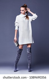 Sexy beautiful woman elegant lady wear casual clothes for every day white wool cashmere merino knitted dress collection high heels shoes fashion style glamour model wear trend brunette bag accessory.