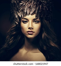 sexy beautiful woman in hat in dark