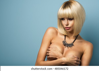 Sexy beauty blond girl over blue background