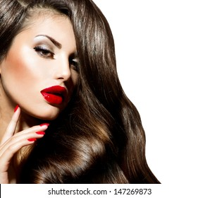 Sexy Beauty Girl with Red Lips and Nails. Make up. Luxury Woman with Long Curly Hair. Fashion Brunette Portrait isolated on a white background. Gorgeous Woman Face.