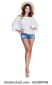 Sexy beauty woman model perfect body shape long hair makeup wear casual summer collection fashion clothes travel journey beach party romantic date white cotton blouse denim short accessory straw hat.