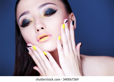 Sexy Beauty Woman Portrait. Professional Holiday Make up for Brunette. Beautiful Fashion Model Girl. Long Hair. Creative Hairstyle, Makeup and Nail Polish