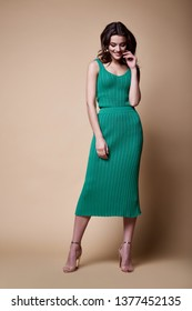 Sexy beauty woman pretty face tan skin wear knitted blouse skirt long skinny body shape makeup cosmetic dress code collection studio catalog brunette curly hair clothes for date office party fashion.