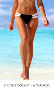 Sexy bikini beach legs woman with slim thighs and body. Cellulite laser treatment wellness spa skincare. Tanned smooth legs and weight loss health concept.