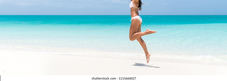 Sexy bikini body perfect slim legs for summer beach holidays panoramic banner. Woman jumping of happiness for weight loss, laser treatment for cellulite, hair removal, concept. Copy space on ocean.