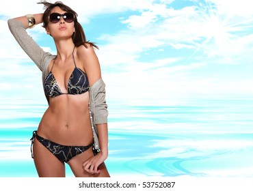 Sexy bikini model over sea background