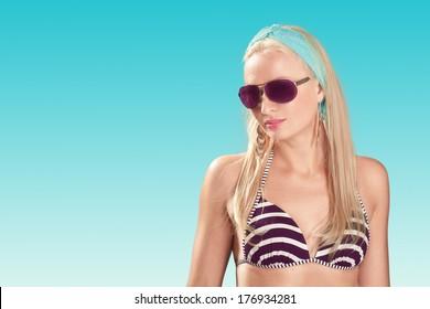 Sexy bikini model wearing sunglasses
