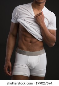 Sexy Black Male Wearing White Underwear on Dark Background