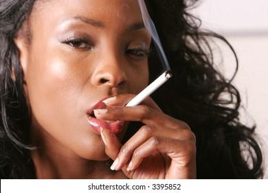 Sexy black woman smoking a cigarette