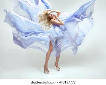 Sexy blond beauty woman in blue dress