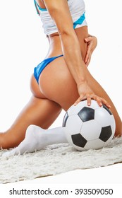 Sexy blond female posing with soccer ball.