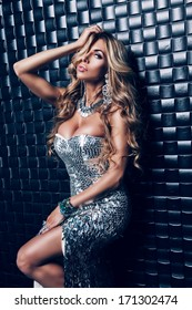 sexy blond woman in silver dress