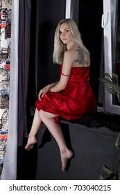 Sexy blonde in a beautiful dress