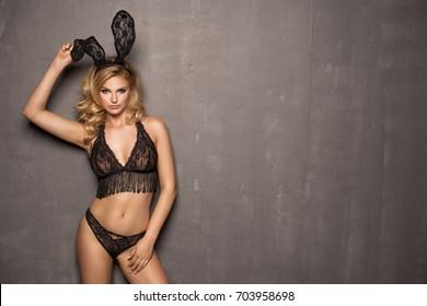 Sexy blonde girl with lace bunny ears
