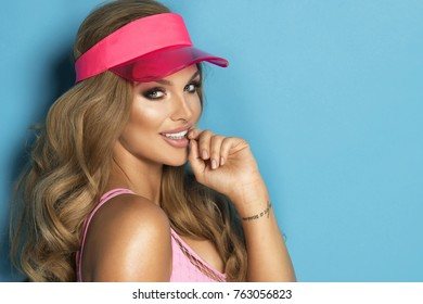 Sexy  blonde girl in pink swimwear