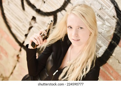 Sexy blonde girl with weapon