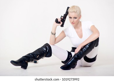 Sexy blonde with a gun in hand.
