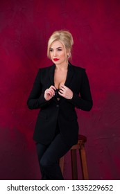 Sexy blonde hair woman in black suit. Fashionable sensual look, pretty business style