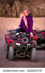 sexy blonde on excursions on quad bikes