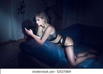 Sexy blonde woman in underwear sending blackmail or message