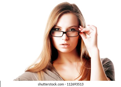 Sexy blonde woman wearing glasses isolated against white background