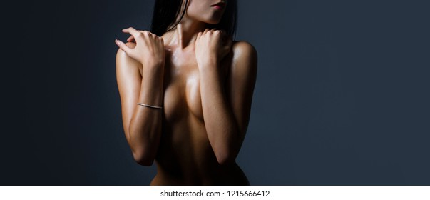 Sexy boobs, breast, tits. Beautiful slim woman body, sexy belly, abdomen. Sensual female boobs. Women with large breasts. Naked woman, nude girl, sensual female, girl. Sexy woman, boob. Copy space.