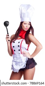 sexy brunette cook wearing uniform and holding a spoon, isolated against white background
