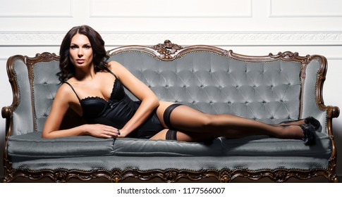 Sexy brunette girl in erotic lingerie in vintage interior