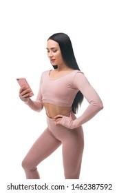 Sexy brunette in pink sportswear shot