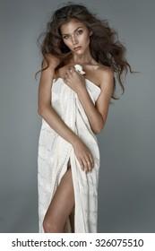 Sexy brunette posing in white