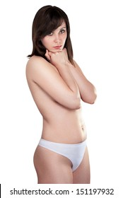 Sexy brunette in white panties covering his hands chest. isolated image