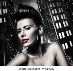 sexy brunette woman with red lips in rainy city