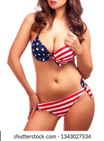 Sexy brunette woman in swimsuit with the american USA flag colors isolated on white background. Lady with perfect voluptuous body