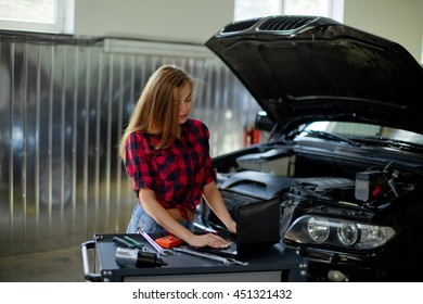 Sexy brunette woman working in the garage.