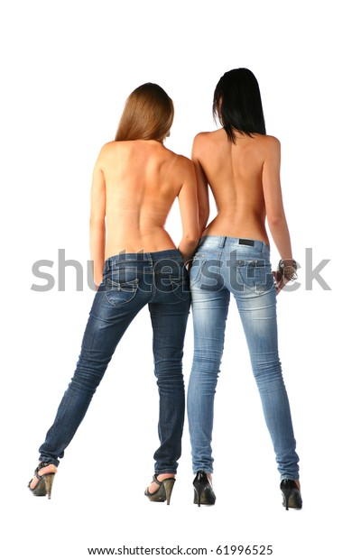 Sexy brunettes in jeans, couple of semi nude women posing in studio on white background. Rear view of slim sexy women in jeans. Full body shot. Back view of full length women, isolated on white