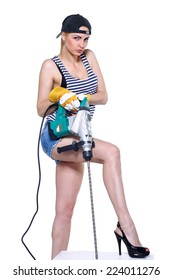 Sexy builder woman with a drill in hands on an isolated white background
