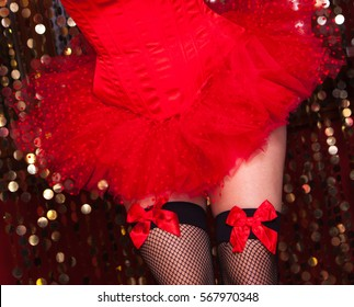 Sexy burlesque dancer with a red corset and legs