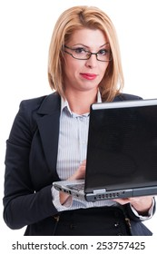 Sexy business woman holding a laptop and looking into the camera