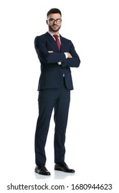sexy businessman wearing glasses standing with arms crossed to chest and posing happy on white studio background
