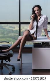 5426dc427ee Sexy Businesswoman Sitting On Desk Underwear Stock Photo (Edit Now ...