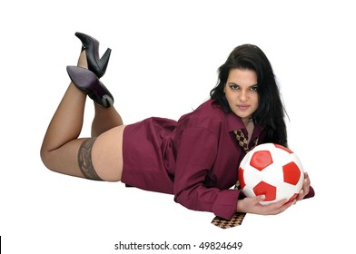 Sexy businesswoman with soccer ball isolated in white