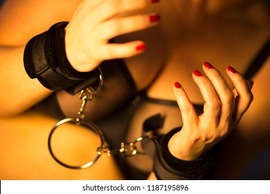 Sexy busty big breasts female model posing in sensuous erotic bondage lingerie underwear chained