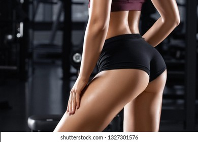Sexy buttocks in thong. Athletic girl workout in gym. Fitness woman