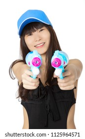 Sexy Chinese American woman wearing a black one piece swimsuit and playing with blue water guns isolated on a white background