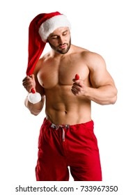 Sexy Christmas santa holding a red strawberry isolated on a white background. Healthy lifestyle concept.